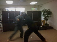 Students working self defense applications at the old dojo